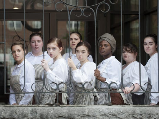 "Members of the St. Michael's College cast of ""Mill Girls"" photographed at the Champlain Mill in Winooski."