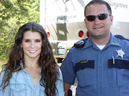 Right, Sgt, Daniel Baker, poses with race driver Danica
