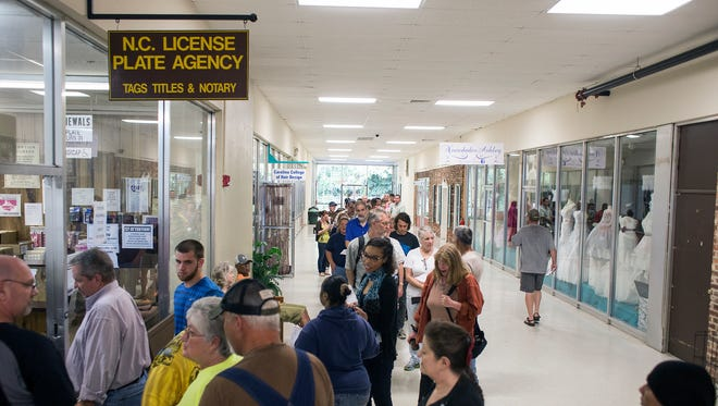 People line the halls of Innsbruck Mall waiting for the N.C. License Plate Agency last year. The Innsbruck Mall was recently featured in The Guardian.