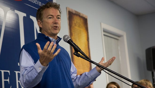 U.S. Senator Rand Paul talks politics to a packed house during a rally with Republican Governor candidate Matt Bevin at Kentucky State University's Baptist Campus Ministry in Frankfort, Ky. October 3, 2015.