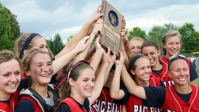 Pacelli High School's Softball Team raises their plaque to their fans after their victory over Three Lakes High School in the Division 4 Sectional Championship game Thursday in Athens.