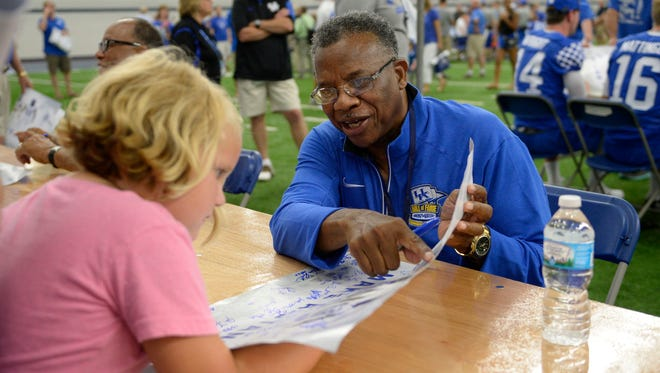 UK Hall of Famer Nate Northington signs autographs during the UK football fan day in Lexington, Ky., on Saturday, Aug. 6, 2016.