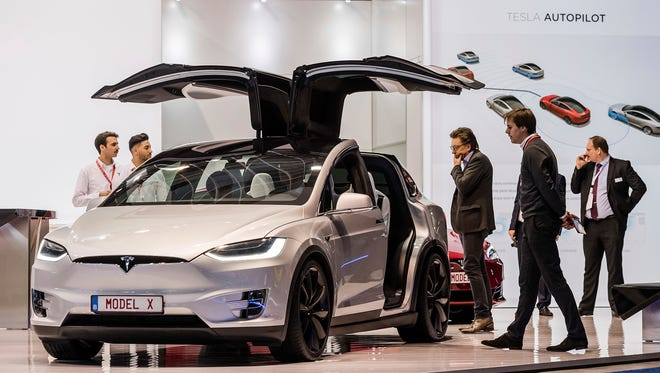 A Tesla Model X reportedly operating on autopilot hit a Phoenix police motorcycle March 21, 2017. The officer wasn't on the motorcycle at the time and no damage was reported to either vehicle. The Tesla Model X on display during the media day of the 95th European Motor Show in Brussels on Jan. 13, 2017.