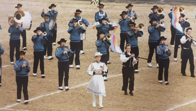 Brandi Sanders Joplin leads the band on the field during her high school days. The 1988 alum credits serving as a Drum Major as a key contributor to her leadership skills.
