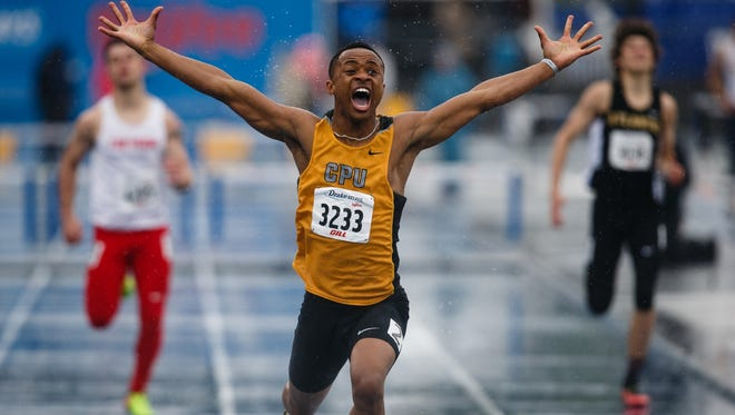 JoJo Frost from Center Point- Urbana reacts after winning the 400 meter hurdles at the Drake Relays on Saturday, April 29, 2017, in Des Moines.