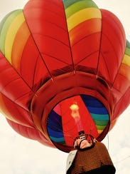 Hot-air balloon is lifted into the sky Friday in Stowe.