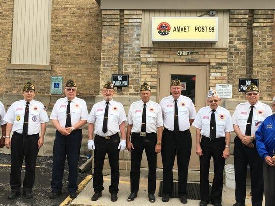 Members of AMVETS Post 99 Honor Guard preparing to