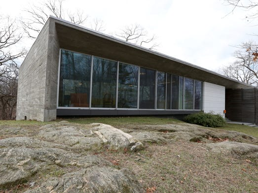A modern concrete and glass house on Kirby Lane North