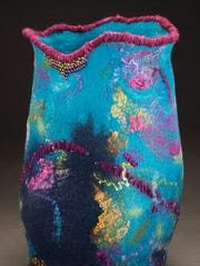 Jan Durham's fiber art includes a wide variety of wall hangings and several large vessels, such as this one that measures over 12 inches tall.