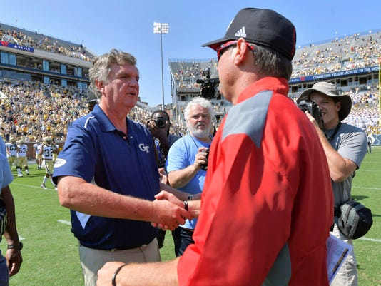 Georgia Tech head coach Paul Johnson, left, and Jacksonville State head coach John Grass shake hands following an NCAA college football game, Saturday, Sept. 9, 2017 in Atlanta. Georgia Tech defeated Jacksonville St. 37-10. (Hyosub Shin/Atlanta Journal-Constitution via AP)