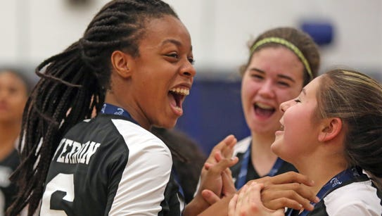 Ossining's Mycheal Vernon (6) celebrates with her team