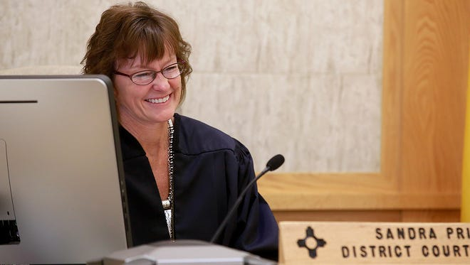 Judge Sandra Price, who plans to retire later this year, presides over an adoption proceeding Friday at the Eleventh Judicial District Court in Farmington.