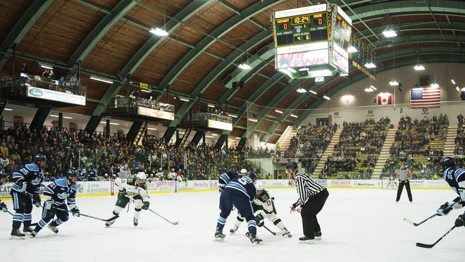 The teams face off during the men's hockey game between the Maine Black Bears and the Vermont Catamounts at Gutterson Fieldhouse on Friday night.