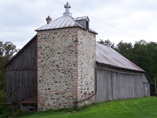 One of few remaining silos of its rectangular shape and fieldstone construction was seen along Christel Road southeast to St. Nazianz during the 2016 Lakeshore Two Cylinder Club's tractorcade.