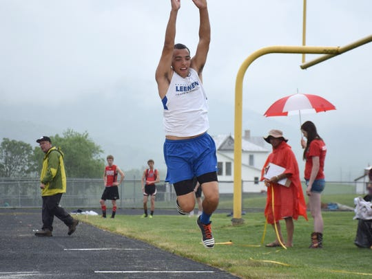 Robert E. Lee's Tre Simmons competes in the boys triple