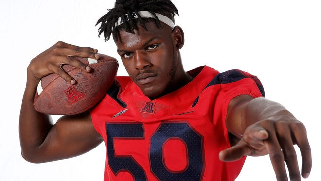 Arizona Wildcats freshman My-King Johnson poses for a photo at Media Day in Tucson on Aug. 20, 2017.