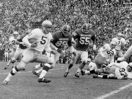 In a photo provided by Michigan State University, Notre Dame's Terry Hanratty carries the ball against Michigan State, Nov. 19, 1966 in East Lansing.