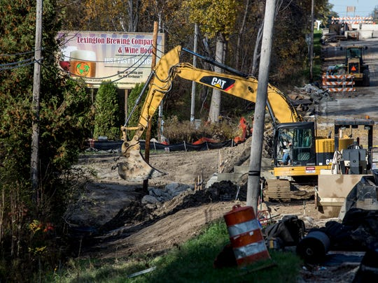 A excavator works on an embankment Friday, Nov. 4, 2016 at the M-25 bridge over Mill Creek in Worth Township. The bridge is expected to reopen on Nov. 22.