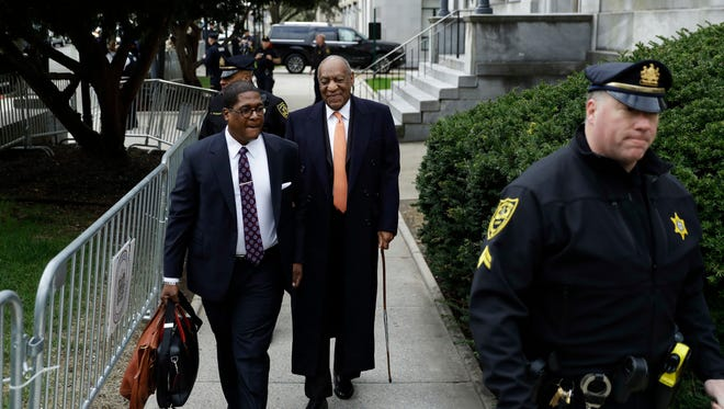 Bill Cosby and spokesman Andrew Wyatt arrive for the seventh day of the comedian's sexual assault retrial Tuesday.