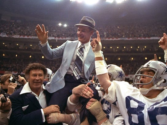 FILE - In this Jan. 15, 1978, file photo, Dallas Cowboys head coach Tom Landry is given a victory ride after the team defeated the Denver Broncos in NFL football's Super Bowl XII in New Orleans. The Cowboys evened their Super Bowl record at 2-2 by taking advantage of eight Broncos turnovers. (AP Photo/File)