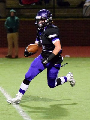 CHCA's John Allen heads up field after picking off a Waynesville pass during the Eagles 24-22 playoff victory over the Spartans.