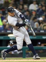 New York Yankees' Aaron Judge connects for a one-run single during the fifth inning of a baseball game against the Detroit Tigers, Friday, April 13, 2018, in Detroit. (AP Photo/Carlos Osorio)