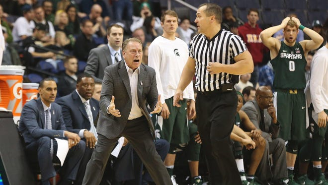 Mar 10, 2017; Washington, DC, USA; Michigan State Spartans head coach Tom Izzo (L) argues a call against the Minnesota Golden Gophers in the second half during the Big Ten Conference Tournament at Verizon Center. The Golden Gophers won 63-58. Mandatory Credit: Geoff Burke-USA TODAY Sports