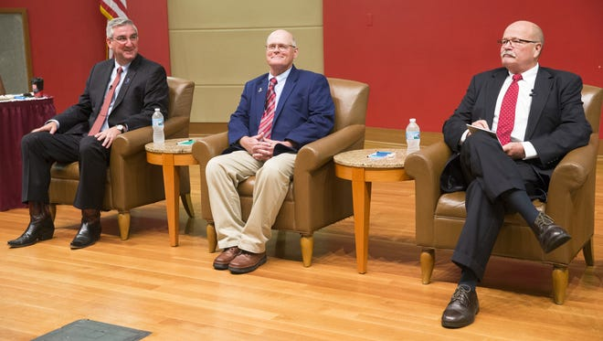 Republican Eric Holcomb (left), Libertarian Rex Bell, and Democrat John Gregg, at a forum for the three main candidates for Indiana Governor, sponsored by Radio One and The Indianapolis Recorder, Central Library, Indianapolis, Sunday, Sept. 25, 2016.