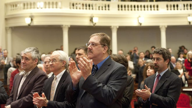 Sec. of State Jim Condos applauds as Gov. Peter Shumlin enters the house chamber at the Statehouse for his budget address on Jan. 15, 2014.