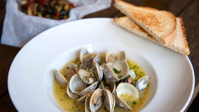 Headhouse Crab & Oysters serves garlicky clams with a rich yet sparkly white wine sauce peppered with herbs.