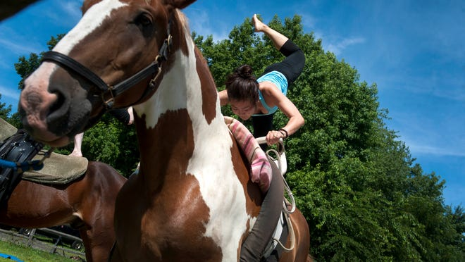 Lumi Wroblewski, owner of Majaka Yoga in Pitman, says <137>that <137>horses are perfect for yoga. They 'actually react to your breath and they actually get calmer, too.'