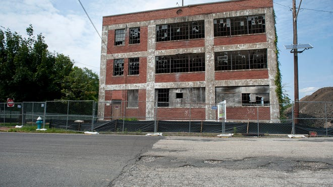 A former knitting mill  at Williams Street and Mitchell Avenue in Burlington City   is being redeveloped, with five new buildings. Top: Mantua Mayor Pete Scirrotto walks   the former Struthers-Dunn site, which was abandoned in 1994. The township had the site remediated, and now awaits development.