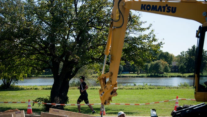 Construction resumes on North Park Drive at Cooper River Park, Friday, September 26, 2014 in Pennsauken.