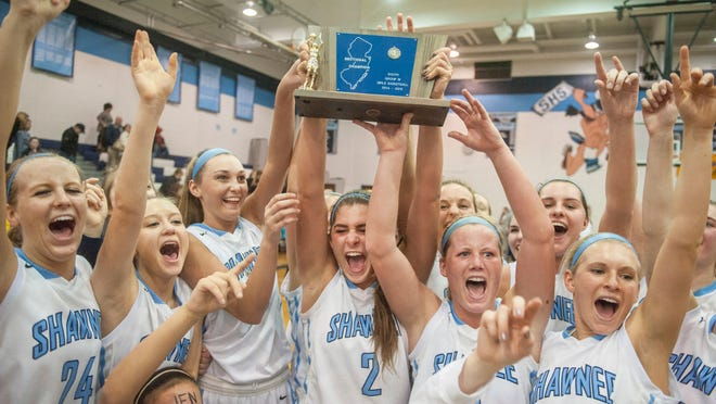 Members of the Shawnee girls' basketball team celebrate after beating Lenape in the S.J. Group 4 final played at Shawnee on Tuesday. The Renegades won 49-38.