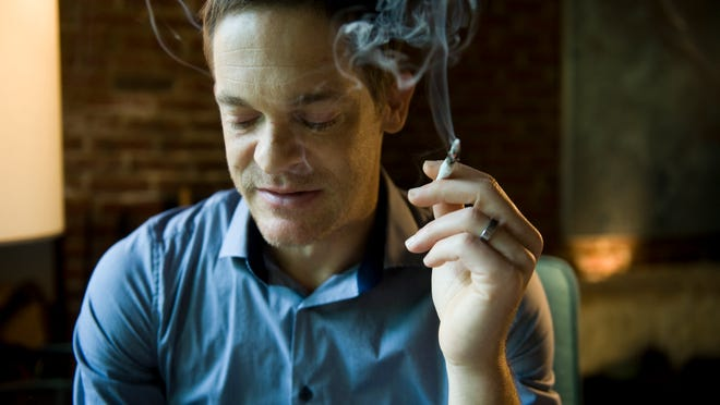 Jay Lassiter of Cherry Hill uses marijuana to help his stomach cope with HIV medications.