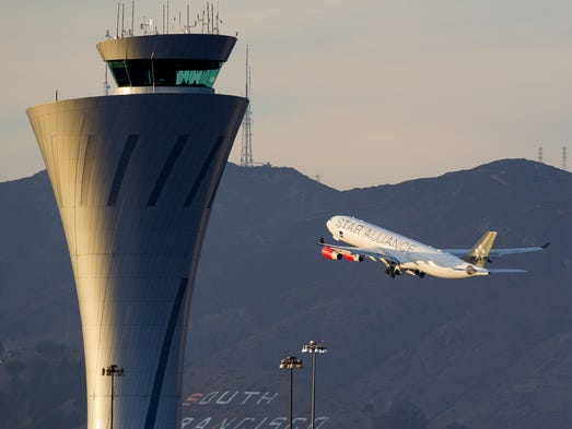 A Scandinavian Airlines (SAS) Airbus A340 slowly lifts