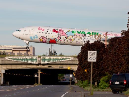 EVA Air's Hello Kitty Boeing 777 touches down at Seattle