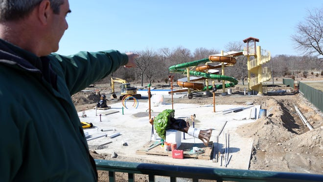 Park manager Christian Nielsen points to the spray ground and waterslide that is being constructed as part of the north end pool complex in Rockland Lake State Park in Valley Cottage, March 6, 2017.