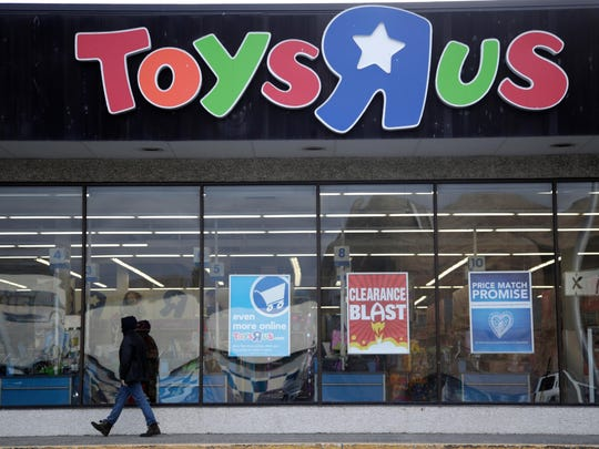This Jan. 24, 2018, file photo shows a person walking near the entrance to a Toys R Us store, in Wayne, N.J. A year after Toys R Us imploded, toy makers are still readjusting to the big loss of shelf space.
