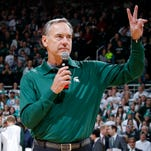 Michigan State football coach Mark Dantonio talks to the crowd during a timeout in the Michigan State-Florida NCAA college basketball game, Saturday, Dec. 12, 2015, in East Lansing, Mich. Michigan State won 58-52.
