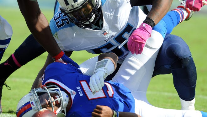 Bills quarterback Tyrod Taylor (5) reacts after a horse collar tackle by Tennessee Titans linebacker Zach Brown on Sunday.