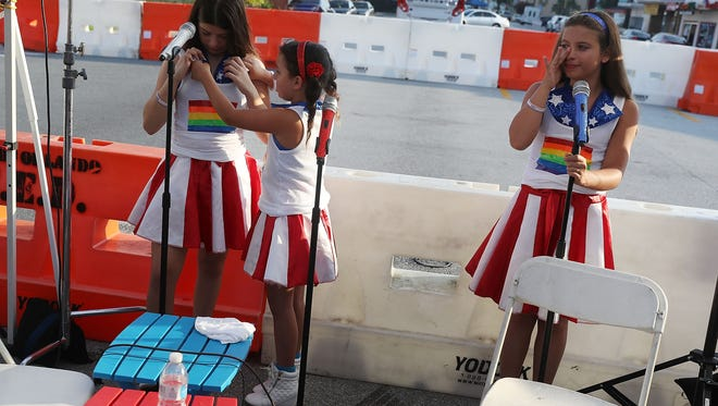 The USA Freedom Kids wait to learn if they will be able to sing the National Anthem as they visit the media area setup near the Pulse gay nightclub after the Pulse nightclub shooting June 15, 2016.