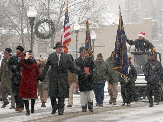 """Actors in """"It's A Wonderful Life""""  costumes parade through the village of Seneca Falls in 2013."""