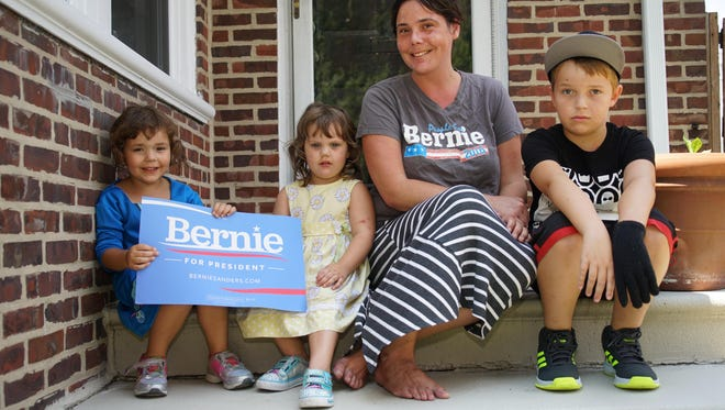 """Christina Chiappine, a mother and 36-year-old leader of Delaware's """"Never Hillary"""" movement, sits with her children (from left) 4-year-old Sunny, 3-year-old Stella, and 10-year-old Miles. Chiappine plans to be protesting in Philadelphia on Monday."""
