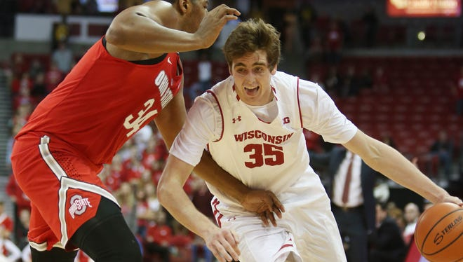 UW's Nate Reuvers drives on Ohio State's Kaleb Wesson during their game at the Kohl Center Saturday.