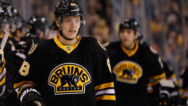 Boston Bruins right wing David Pastrnak (88) will use up the first year of his entry-level contract once he plays his 10th game.
