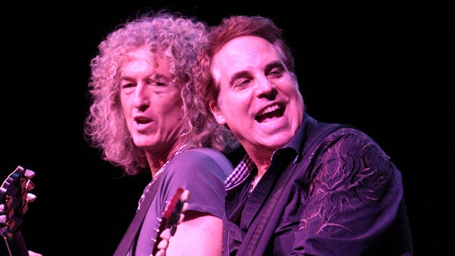 Bruce Watson and Thom Gimbel of the classic rock band Foreigner perform in concert at the American Music Theater in Lancaster, Pa. Two South Jersey choirs are vying for a chance to perform with the band,