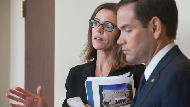 Senator Marco Rubio listens as US District Court Judge Casey Rodgers speaks to the media after taking a tour of the currently vacant federal courthouse in Pensacola on Wednesday, July 20, 2016.  The courthouse is dangerously infested with mold and in need of immediate repairs.