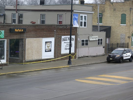 Crime scene tape remains in place at Eagle Nation Cycles
