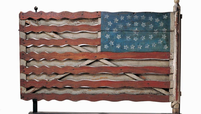 """""""Flag Gate"""" by an unidentified artist is part of an exhibition by New York's American Folk Art Museum called """"Self-Taught Genius"""" that celebrates the creativity of artists with no formal training."""